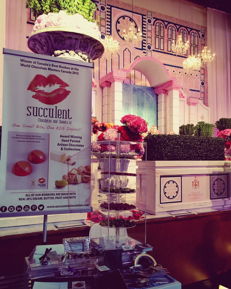Our booth in front of the beautiful flower room at this years WedLuxe show.