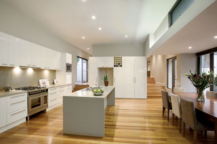 A fabulous north facing kitchen with stone benchtops and Euro stainless steel appliances