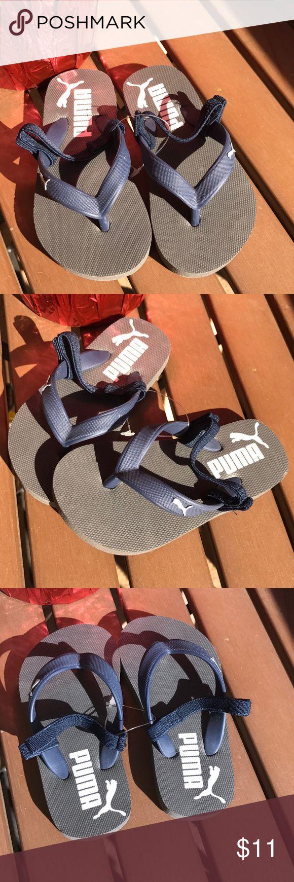 New Puma toddler flip flops sandals New Puma toddler flip flops. Size 8c with elastic heel strip. Dark blue. Soft foot beds. Puma Shoes Sandals & Flip Flops