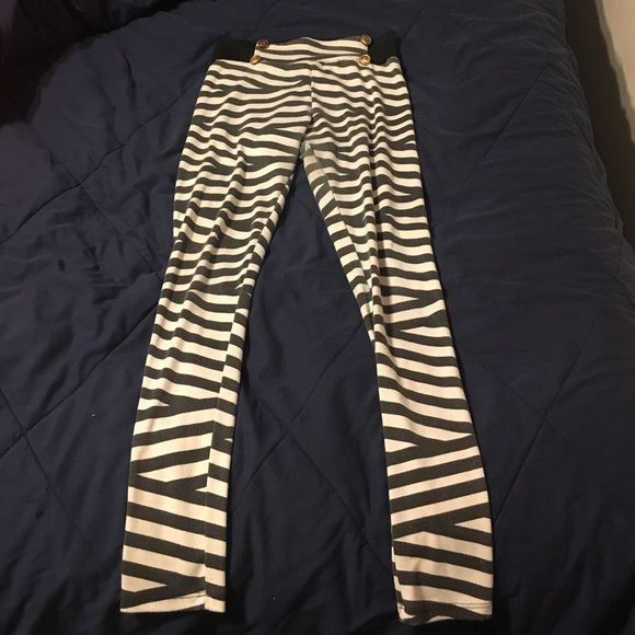 High wasted pants Black and white striped high wasted pants with 4 gold buttons on the front, the black is a little faded but still in good condition Pants
