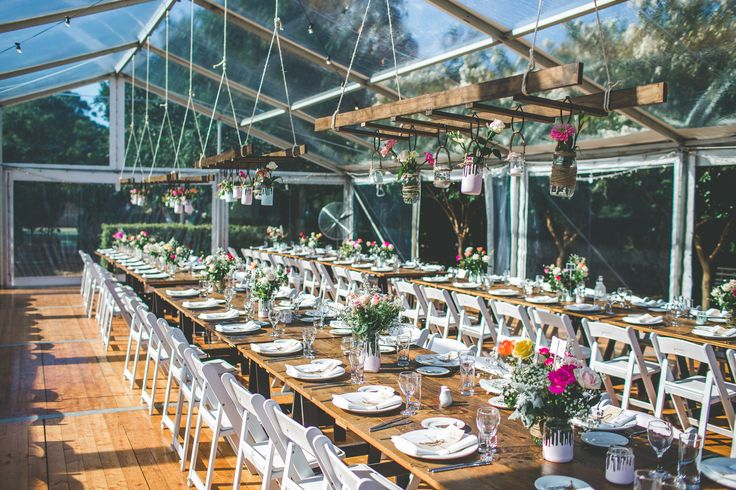 10m marquee structure, full clear roof, clear walls, festoon lighting, vintage timber trestle tables, white padded folding chairs, south coast weddings, south coast party hire