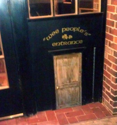 "This Irish pub does not discriminate. There is a regular people entrance and a ""wee people's entrance.""    Find more funny business signs at www.funnysigns.net"