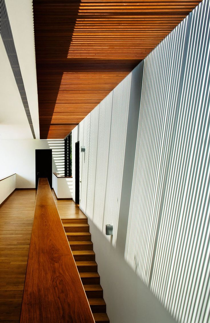 Bold Wood Accent as Steps Also Floor Completed Among Perforated Ceiling