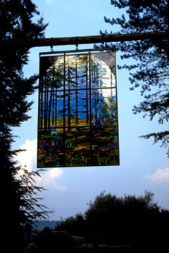 Details of Kevin Atherton's 'Cathedral' - a stained glass piece hung from a tree at the Forest of Dean Sculpture Trail.