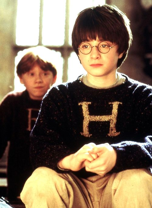 Harry and Ron wearing knitted sweaters made by Mrs. Weasley.