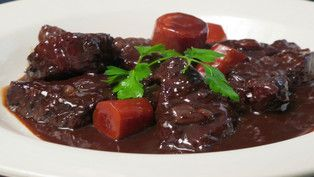 """Anthony Bourdain's Boeuf Bourguignon. """"This dish is much better the second day. Just cool the stew down in an ice bath, or on your countertop. Refrigerate overnight. When time, heat and serve. Goes well with a few boiled potatoes. But goes really well with a bottle of Cote de Nuit Villages Pommard."""" Washington Post"""