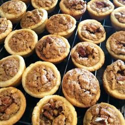 Tiny Pecan Tarts Allrecipes.com.  These remind me of my mom and the holidays.  Great hostess gifts.