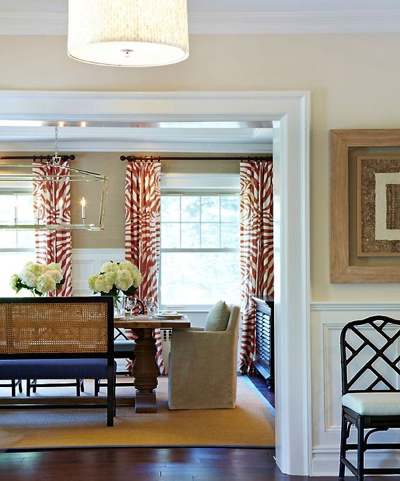 A View Into The Dining Room Showcases Bold Zebra Printed Draperies In Orange Rustic Table Made From Reclaimed Wood Is