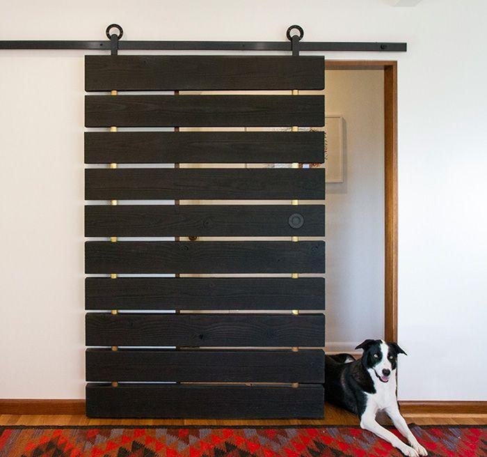 joe mansfield created this custom screen door with charred wood planks and the baldur sliding hardware
