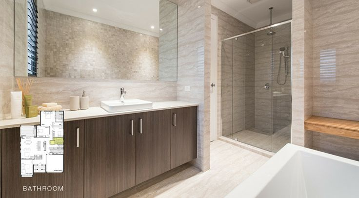This dazzling bathroom includes a large mirror for added style and practicality. #worldconcepthomes #home #house #bathroom #interior #decorating