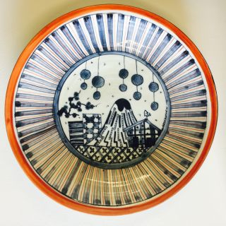 Stunning red and blue glazed porcelain platter with Japanese influenced illustration