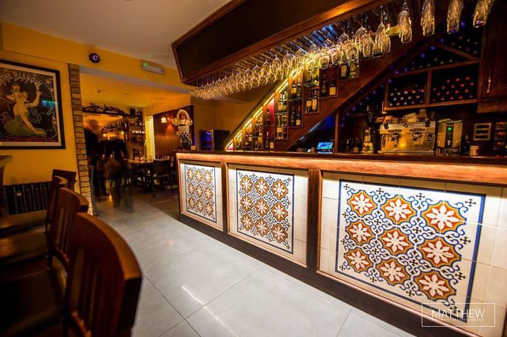 Colourful patterned encaustic cement tiles photographed at The Olive Tree Tapas and Wine Bar in Waterford City, Ireland. These are available on our website https://best-tile.co.uk/moroccan-encaustic-cement-tiles/moroccan-pattern