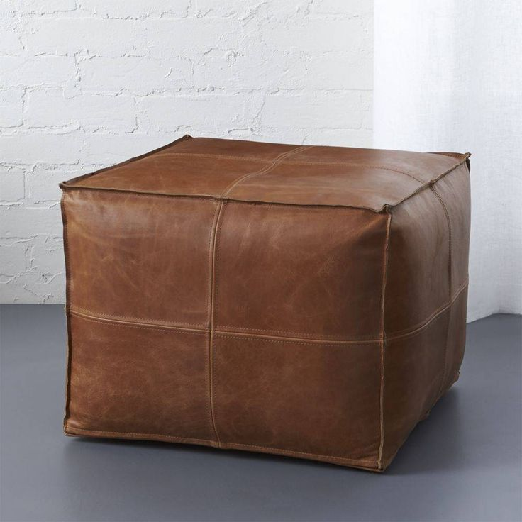 """""""handsome hide. Introduce hide to your habitat via authentic aniline-dyed buffalo leather, revealing natural grain and texture that wears and softens over time. Hand-stitched quadrants shape up sides with flange edging. Squares up as ottoman or occasional seating. -Exterior: 100% top-grain, semi aniline-dyed buffalo leather -Interior: 75% cotton sheeting, 25% olefin -Hand-stitched -Polystyrene bead fill -Bottom zipper closure -Spot clean only with damp cloth and wax or leather cleaner -..."""