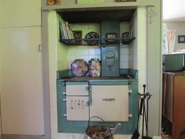 Green tile surround of a 1950's wetback coal range in 2 bedroom home @ Waratah St, Birkenhead.