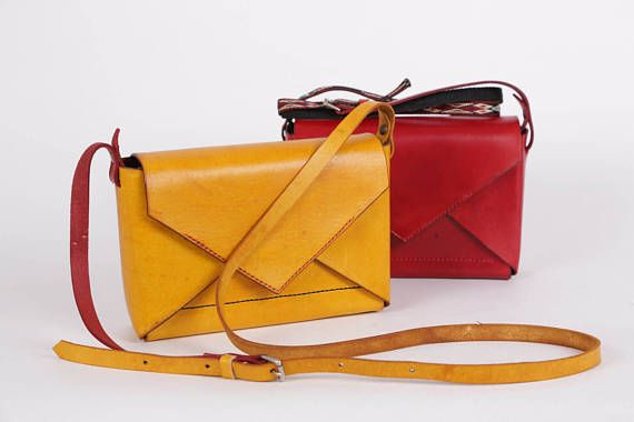 Mini EnVelope Cross-body bag   This handcrafted yellow cross-body is perfect for carrying your personal items wherever you go and ideal for individual who like to carry their stuff in style. It perfectly combined with either your casual or smart outfits. This leather envelope bag is designed by me in Manchester, United Kingdom. This unique and light handcrafted leather bag is entirely hand-stitched and dyed by hand in yellow. To make this bag, I use a high quality vegetable tanned leather…