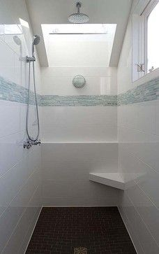 Simple white tile with a glass splash traditional bathroom by David Neiman  Architects