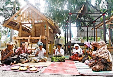 Aceh People (Acehnese),   Nangroe Aceh Darussalam Province, Indonesia. Praying before building a house