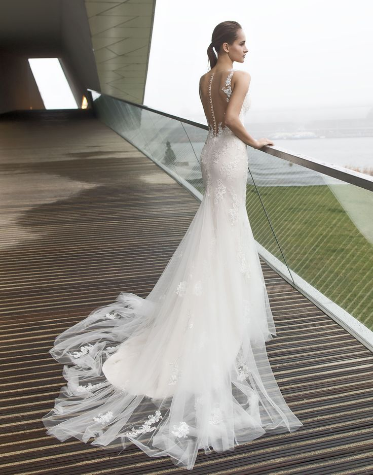 BOSTON // A soft and dreamy lace wedding dress with a low illusion back finished with diamante buttons