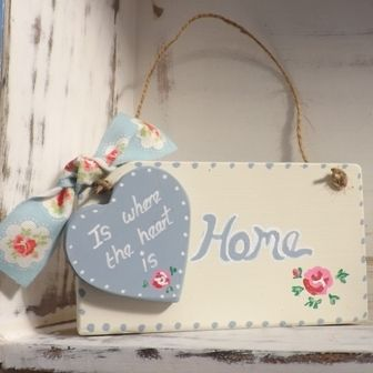 This Handmade home is where the heart is plaque with Cath Kidston ribbon, would make a great! House warming, new home gift.  Made from hand cut solid wood, which has been hand painted in cream paint. Home text painted in pale blue. A wood heart, Painted in pale blue with, white text that say's, 'Is where the heart is'. Finished with Cath Kidston ribbon. Vintage string to hang.