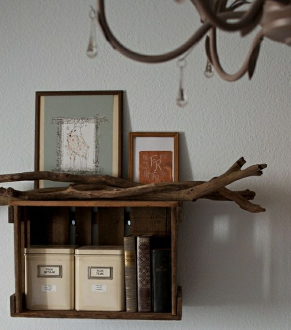 Shelf wine boxes rustic driftwood branches books picture antler chandeliers