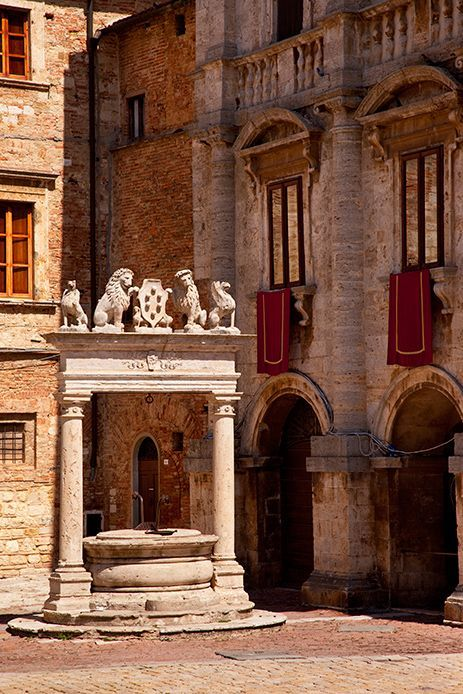 Montepulciano, Tuscany.  Fountain...or baptismal portal? Note lion strength/protection/ally overhead.