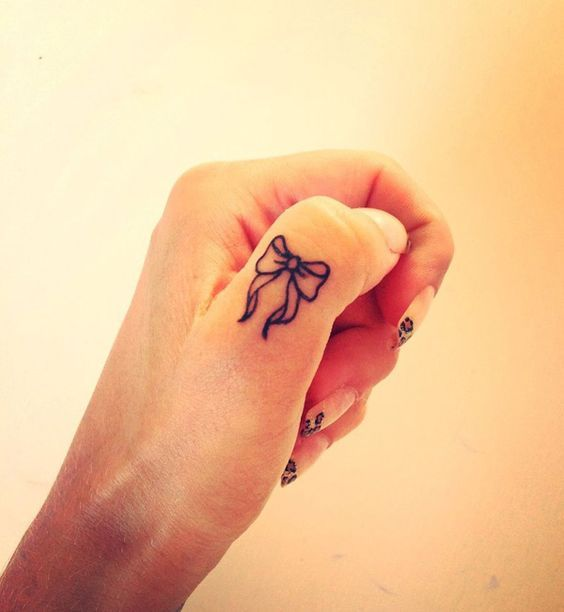 A bow - perfect for any girl - Amazing Finger Tattoo Ideas. #Tattoo #Inked #FingerTattoo #WomenTriangle