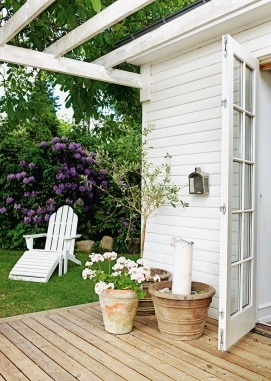 or just pergola without roof. roof it later, save money now. but create an outdoor seating area and alternate rear entrance to house