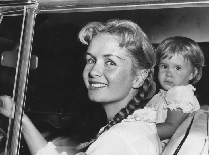 Going for a Ride from Debbie Reynolds & Carrie Fisher's Mother-Daughter Moments  DebbieandCarrie, then 23 months old, leave their Los Angeles home in 1958.