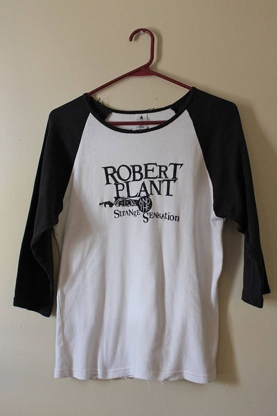 This shirt is a one of a kind, each shredded shirt is different.  This one is a Robert Plant and the Strange Sensation tee. Heres your info on it - - Size X Large, check measurements  - Across chest flat, pit to pit -20 (40 around)  - Shoulder down, front - 24  If you need more info or have any questions, just yell, were around to help you out.  If youre ordering from a location not listed, message us and well quickly calculate shipping to you.  Follow us on Pinterest - https://www....