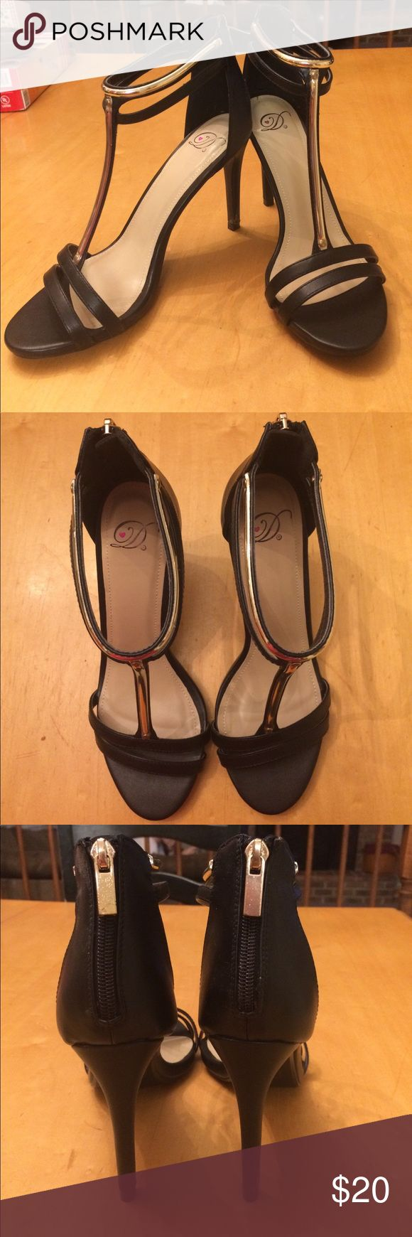 Cute gold and black heels Super cute gold and black heels! Only worn a couple times but still in good condition! See slight wear on the bottom Charlotte Russe Shoes Heels