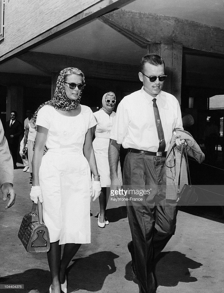 During the Olympic Games in Rome, Princess GRACE of MONACO, visiting her brother Jack B. KELLY who was a member of the U.S canoeing team, walked beside him in the Olympic Village.
