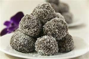 Tim Tam Balls yum - just 2 pkts tim tams- 250gm cream cheese and shredded coconut. easy!!