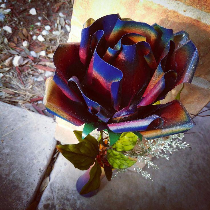 A beautiful rainbow rose arrangement - metal flower art