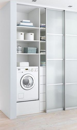 white modern laundry with sliding door