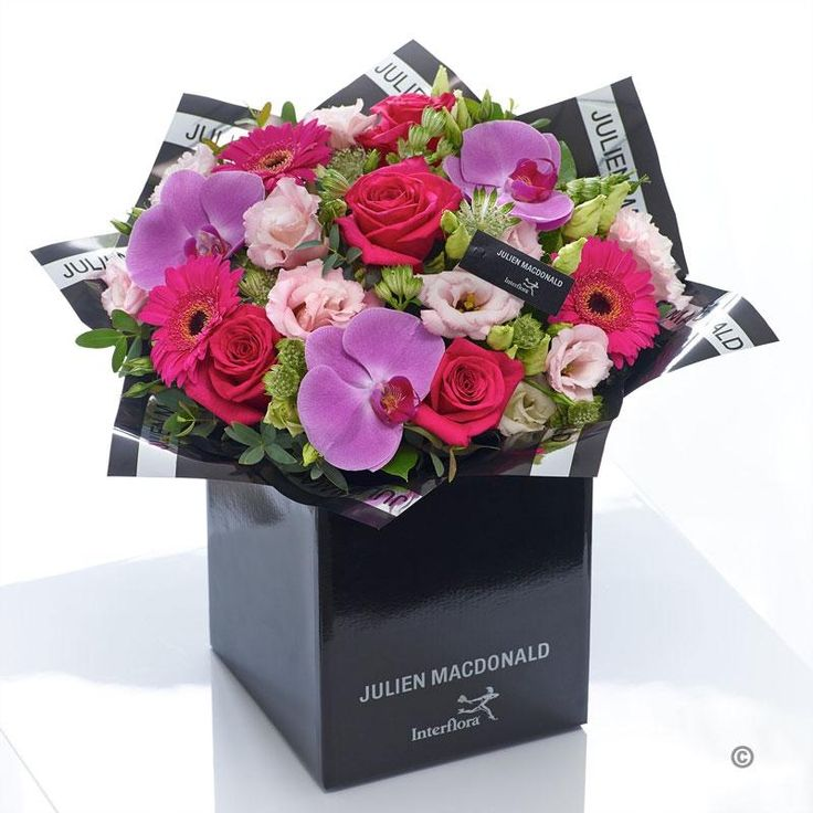 This wonderfully feminine bouquet has a stylish, modern feel, showcasing a stunning selection of fresh flowers to brilliant effect. Lustrous lilac and cerise is complemented perfectly with light pink and vibrant green tones. It's a colour palette that lifts the mood and looks just sensational.