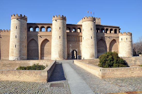 The Aljafería Palace is a fortified medieval Islamic palace built during the second half of the 11th century in theMoorish taifa of Zaragoza ofAl-Andalus, which is now present dayZaragoza, Spain. (A taifa was an independentMuslim-ruled principality, usually anemirate orpetty kingdom.)Early in the 8th century (711 A.D.)a group made up of Arab and Black African tribes invaded and conquered most of what is now called Spain. Inthe English language, we call these invadersthe Moors…