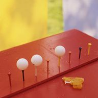 shoot ping pong balls off the tops of golf tees or two liters with a water gun. Push gold tees into styrofoam block or set up about five two liters in a row with lids removed.  Place ping pong balls on top and let the player shoot until all the water is gone from their gun. Decide how far back they should shoot depending on their age. Don't forget to have a bucket of water nearby for gun refills