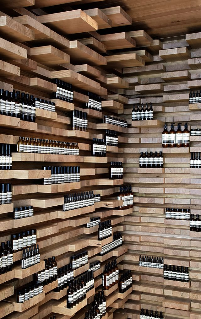 "AESOP ON RUE SAINT-HONORÉ. Designed by March Studio (Australia). ""The wood is... Victorian ash (from the eucalyptus family), an Australian grown renewable timber, which was hand-cut into about 3500 pieces before being sealed, numbered to meticulous plans and then sent off in shipping crates to be built in Paris..."" #shelving"