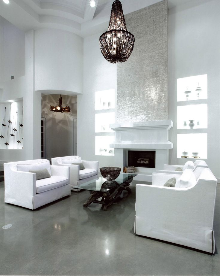 White Walls Contrast With Polished Grey Concrete Floors By