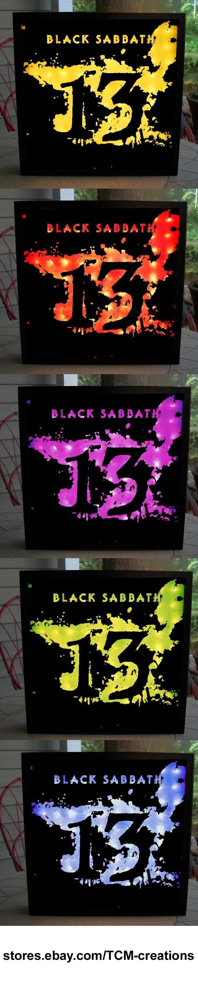 Back Sabbath Shadow Boxes with LED lighting. Ozzy Osbourne, Tony Iommi, Geezer Butler, Bill Ward, Ronnie James Dio, Paranoid, Master Of Reality, Vol. 4, Sabbath Bloody Sabbath, Sabotage, Technical Ecstasy, Never Say Die!, Heaven and Hell, Mob Rules, Born Again, Seventh Star, The Eternal Idol, Headless Cross, Tyr, Dehumanizer, Cross Purposes, Forbidden, 13.