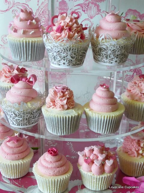 Love the unique designs in each of the pink cupcakes in a tower #wedding #weddingcupcakes #pink #cupcakes #cupcaketower