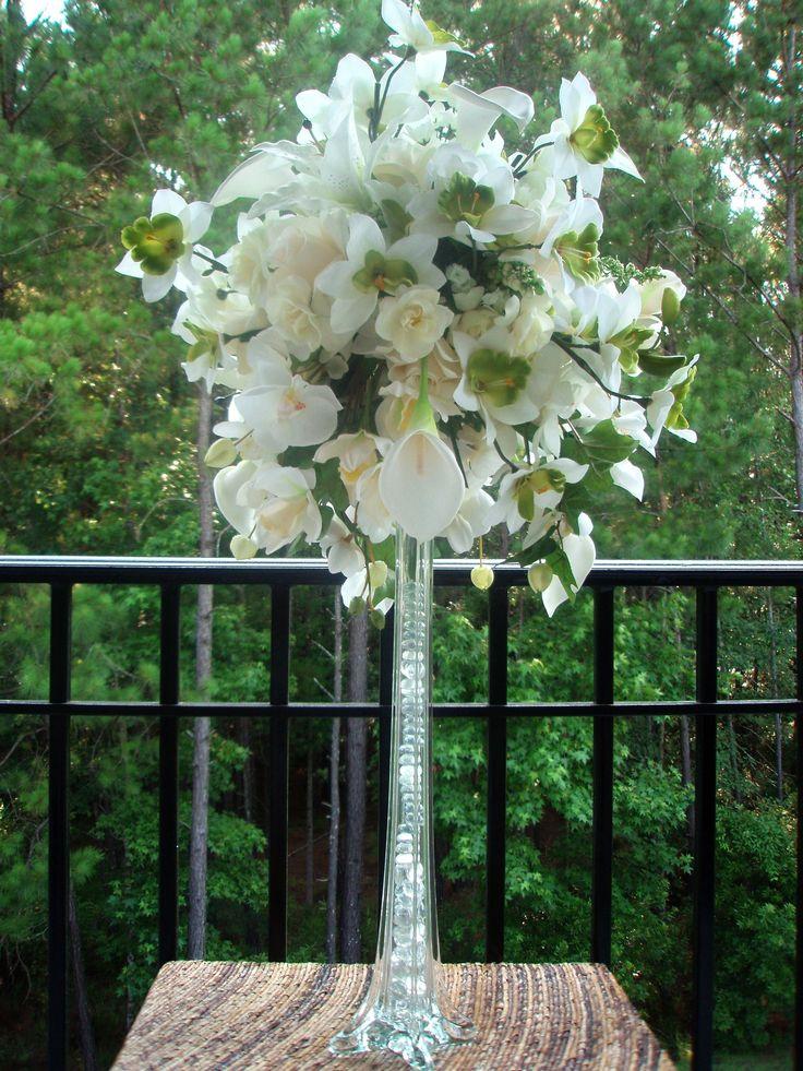 Photo via eiffel tower vases flower arrangements and