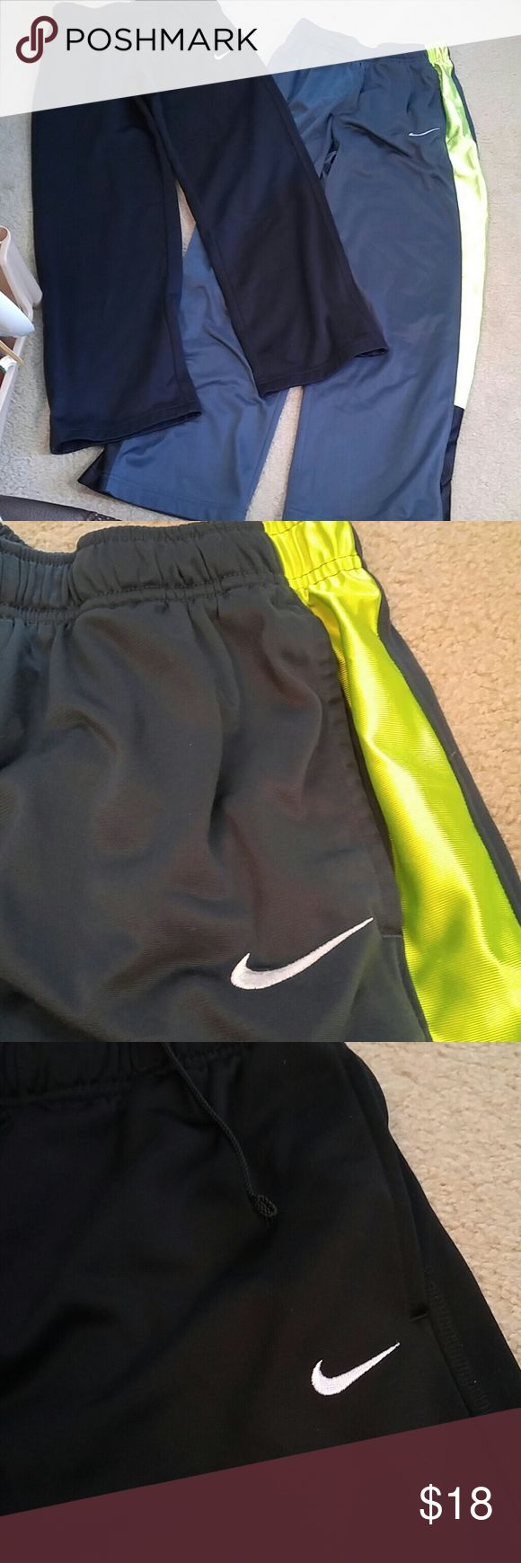 Bundle 2 Pair Boys Nike Athletic Pants L (12-14) Bundle 2 Pair Boys Nike Athletic Pants. Both size L (12-14). One pair is black with white swoosh.  These are lined with thin fleece. The other pair are Gray with neon yellow. Unlined. Both in Excellent shape. No wear to knees. No rips or tears. Nike Bottoms Casual