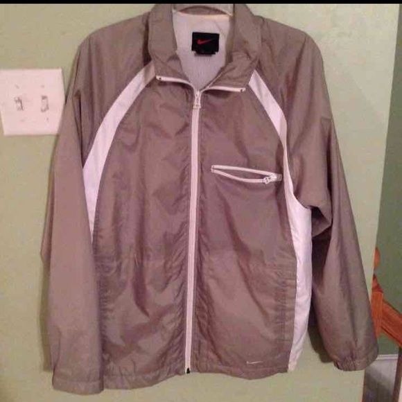 Nike women's windbreaker never worn Perfect condition.  Smoke and pet free home. Ready to ship today Nike Jackets & Coats