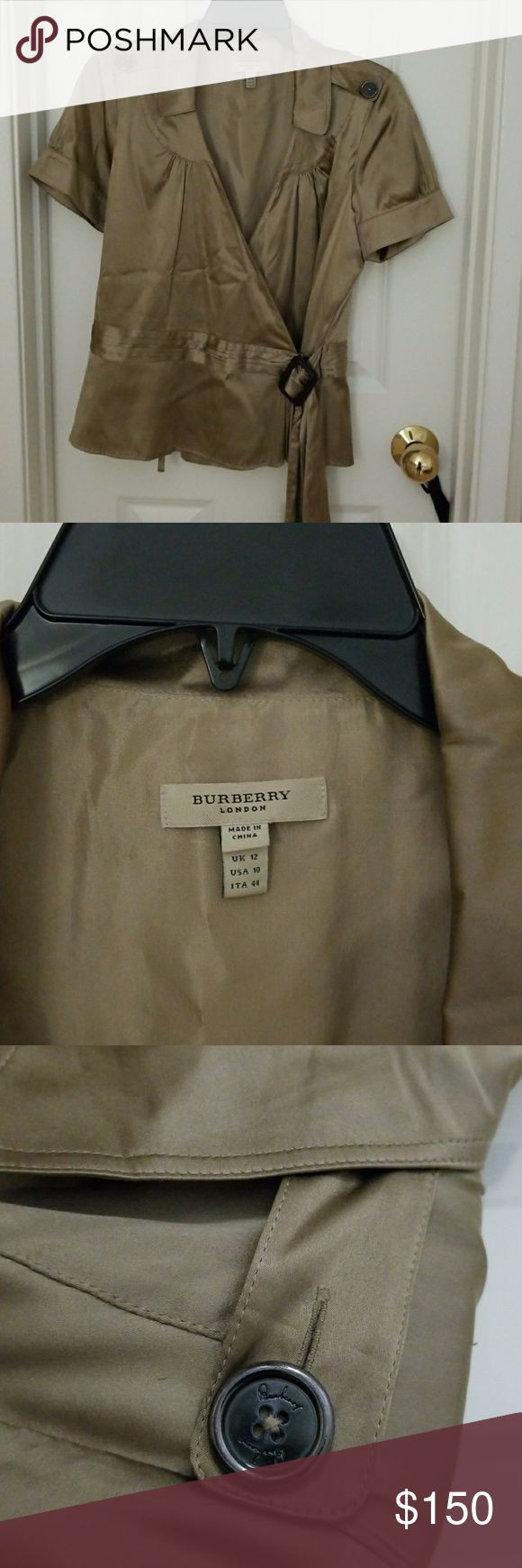 Burberry Blouse NWOT...Never worn. Tan/ taupe silk blouse. Short sleeves, rouching on sleeves and chest. Wrap style waist with leather buckle. Bought it from Nordstrom discounted so am offering it at a deep discount. Price is of a similar item. Burberry Tops Blouses