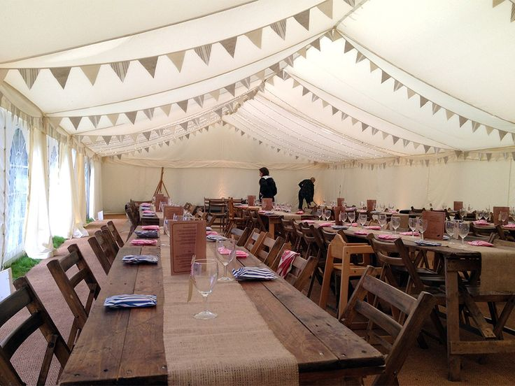 Understated (not quite finished) vintage wedding marquee with bunting, bare tables and burlap table runners #marquees #vintage