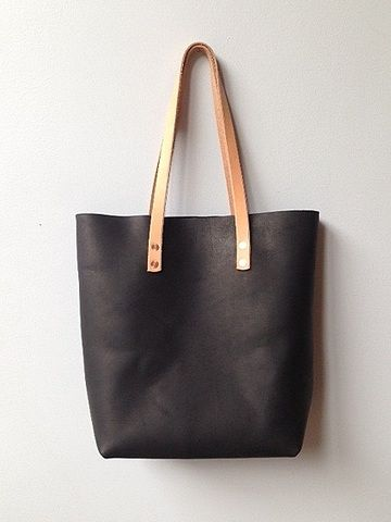 black leather bag with tan handles