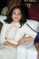 Nitya Menon New Stills at MMIRR Audio Launch, South Actress Nitya Menon glamorous photos in white at Malli Malli Idi Rani Roju Audio Launch