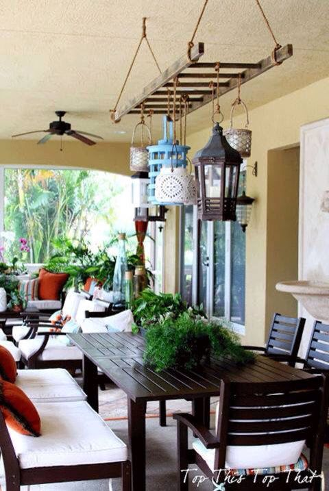 Cute outdoor light fixture made from wooden ladder and lanterns.