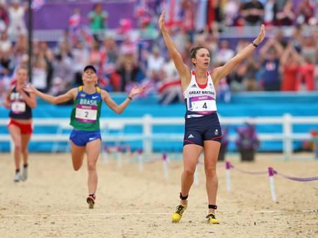 Silver medallist: Samantha Murray celebrates as she crosses the finish line during the women's modern pentathlon